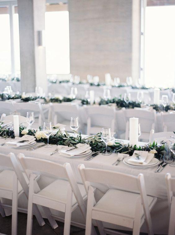 stylemepretty.com white resin folding chair.jpg