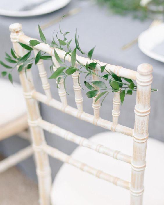 white chiavari chairs with ivy.jpg