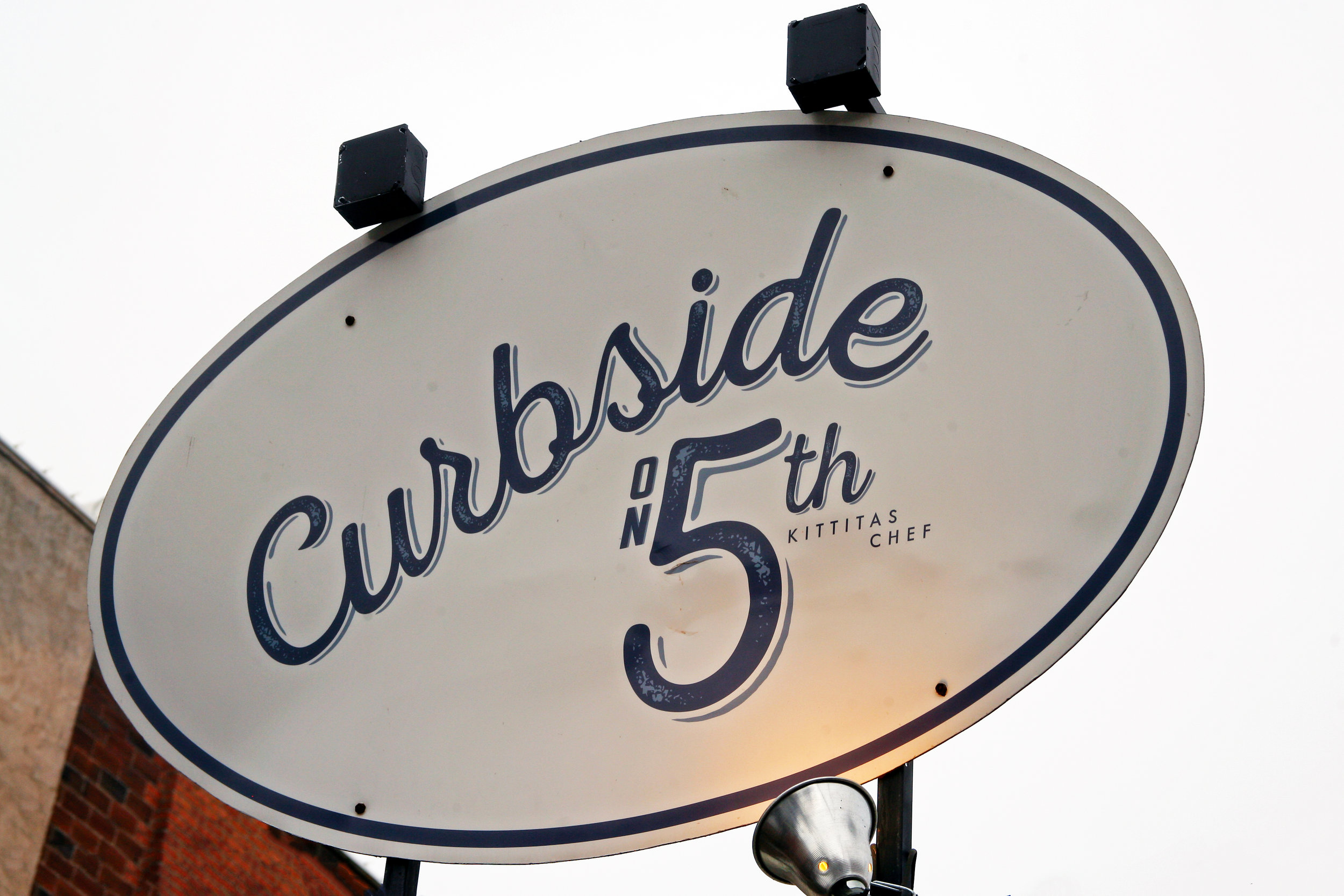 Curbside Sign.jpg