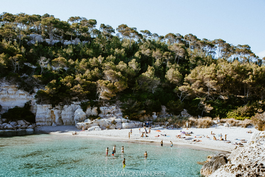 The beach of Cala Mitjana on Menorca, Spain - The Common Wanderer