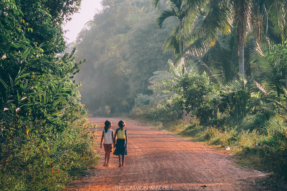 friends walk back to Chi Phat village, Cambodia