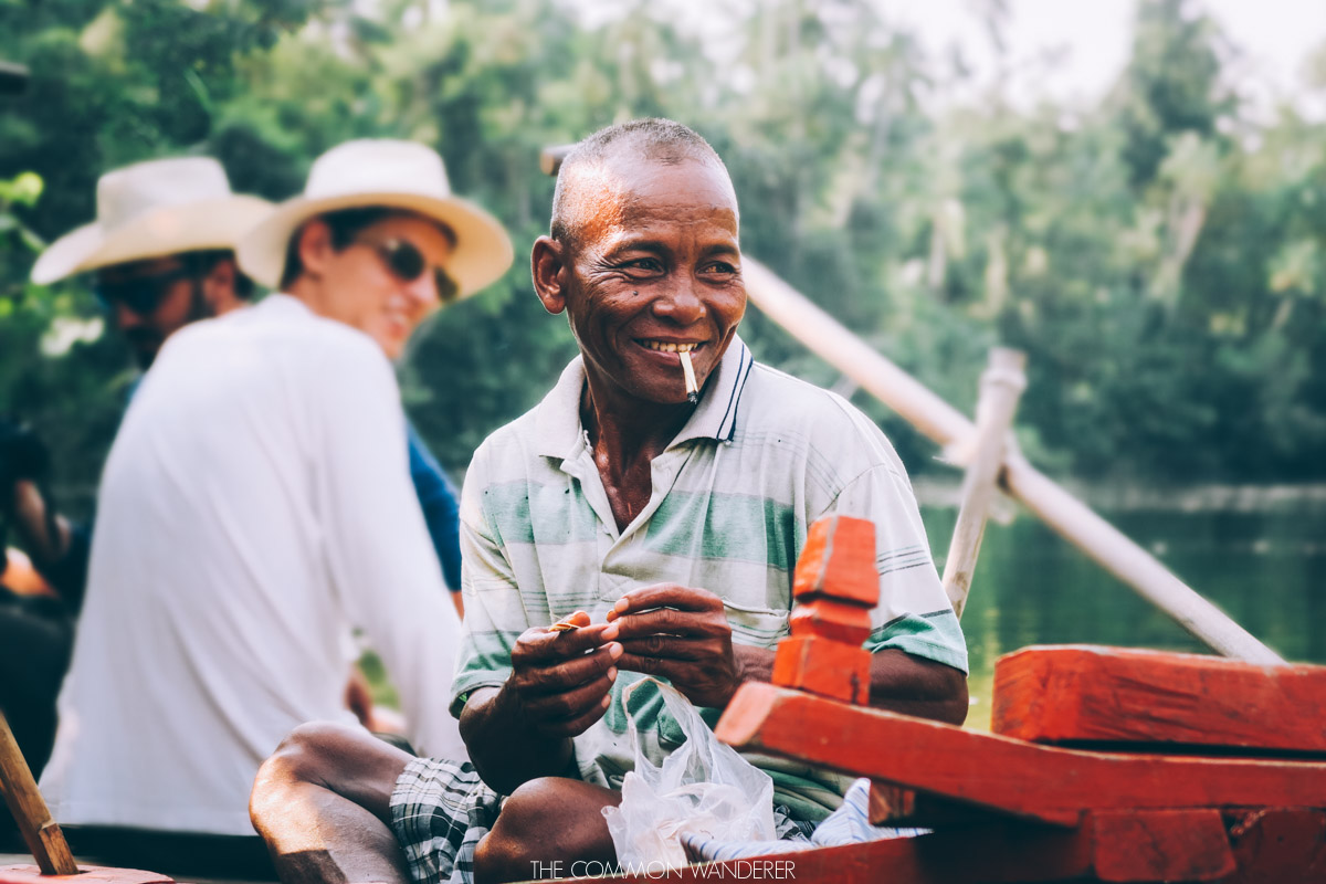 Chi Phat ecotourism project Cambodia a local smokes on the river