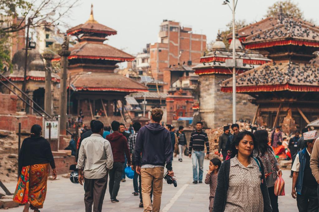 Man walking through Kathmandu Durbar Square