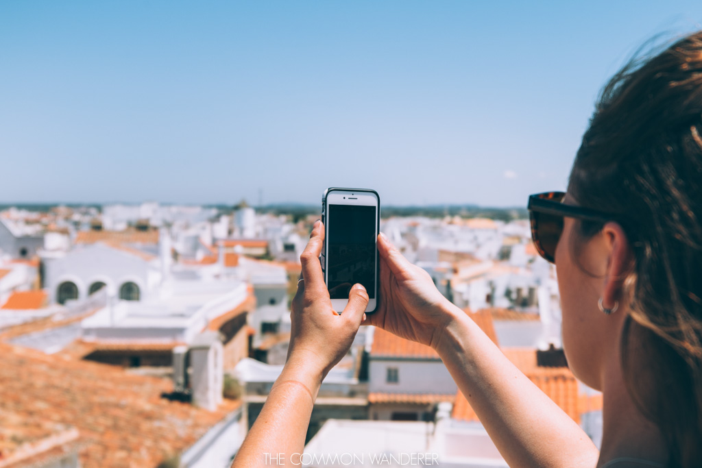 Taking a photo over the rooftops of Menorca - The Common Wanderer