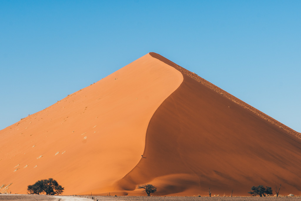 Climbing the Sossosuvlei dunes of Namibia
