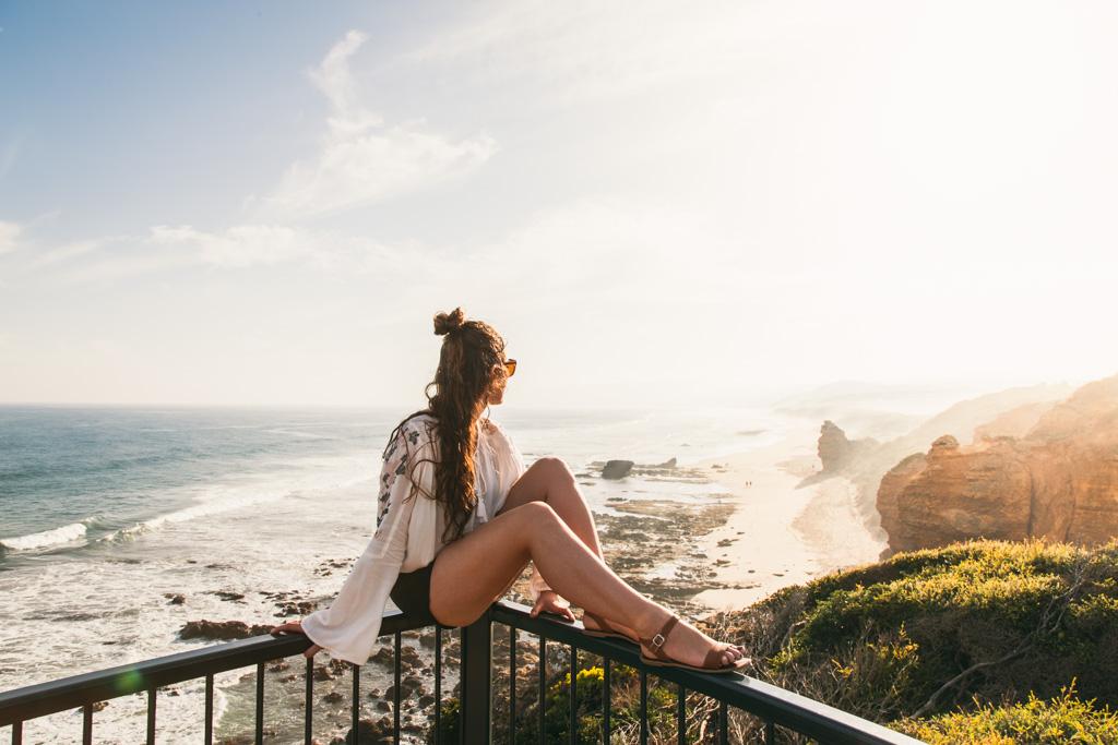 A woman overlooks Fairhaven Beach, The Great Ocean Road, Victoria