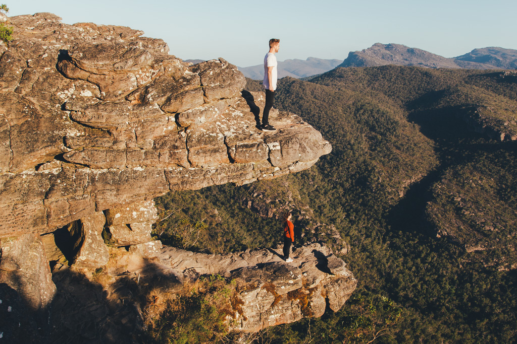 A man and woman stand on the balconies, Grampians National Park, Victoria