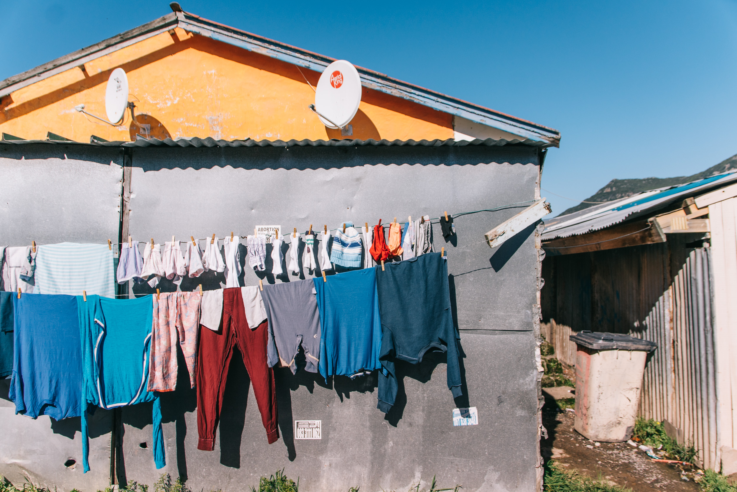 Washing hangs on the streets of Imizamo Yethu, Cape Town