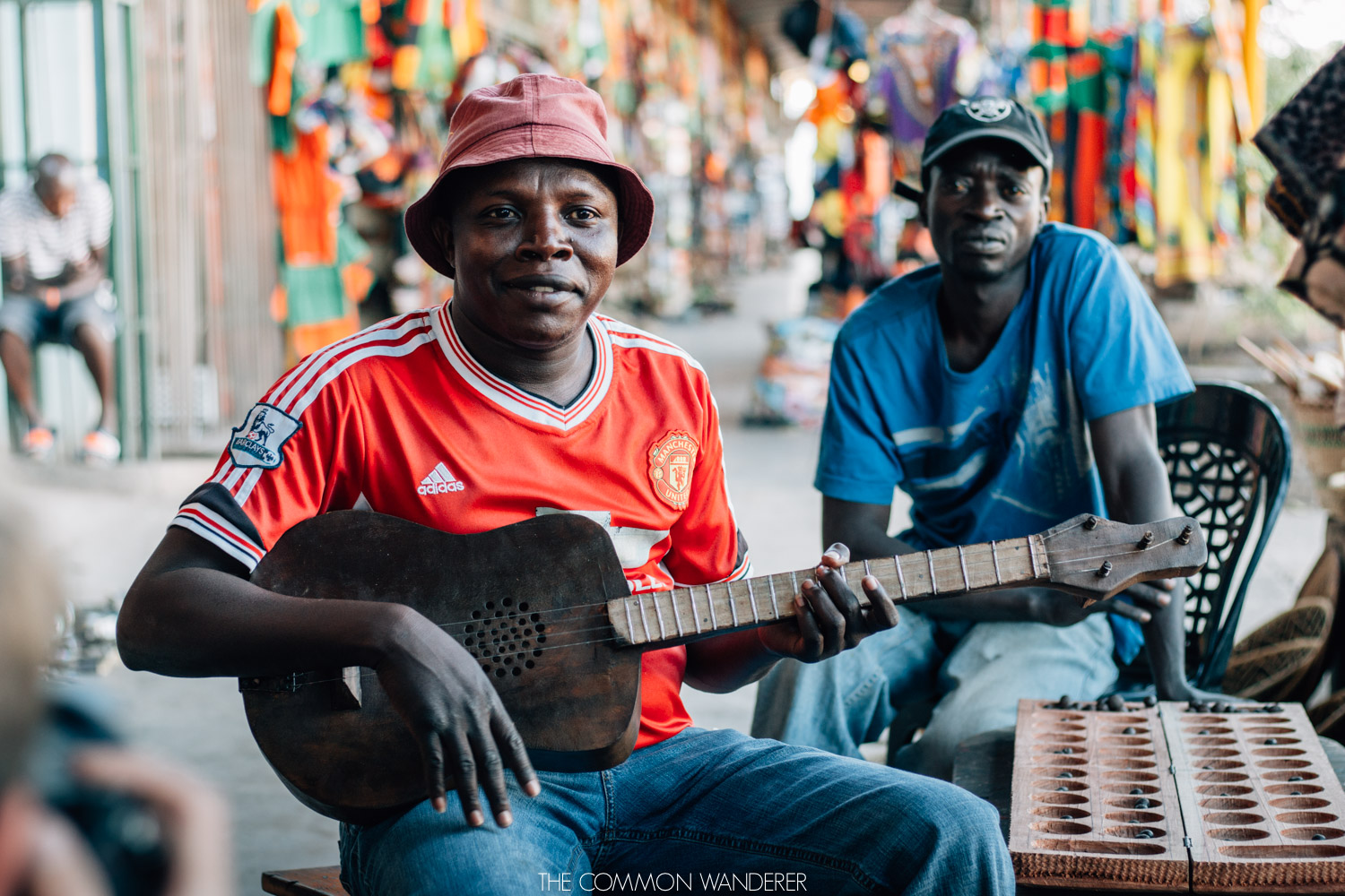 The Common Wanderer - Man plays guitar in Livingstone markets, Zambia