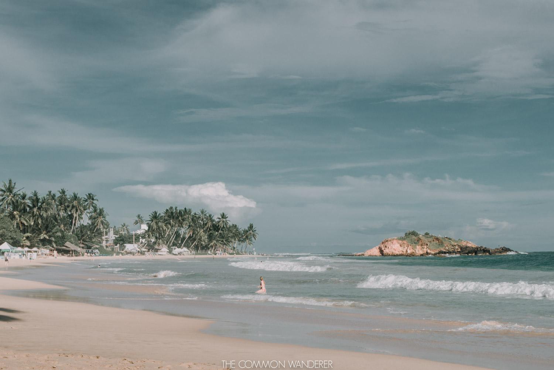 woman-swimming-at-mirissa-beach-sri-lanka