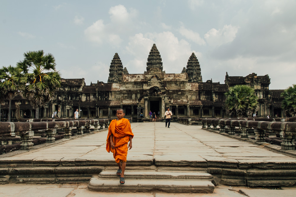 Cambodia photo diary a novice monk walks through angkor wat