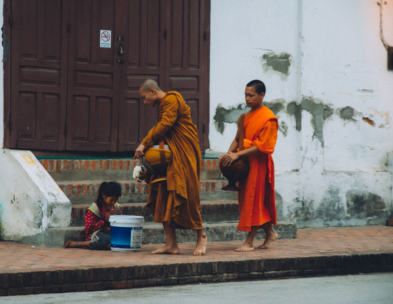 morning alms in luang prabang Laos