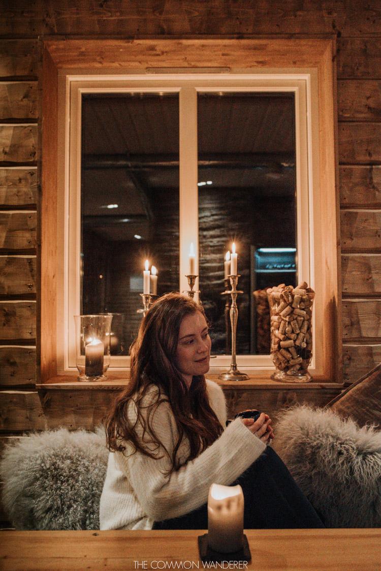 Girl in cosy cabin in Pjesker, Swedish Lapland