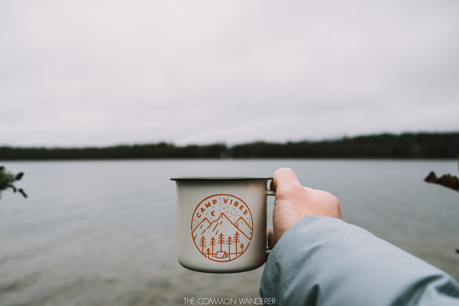 camp vibes cup in front of lakes in Sorsele Swedish Lapland