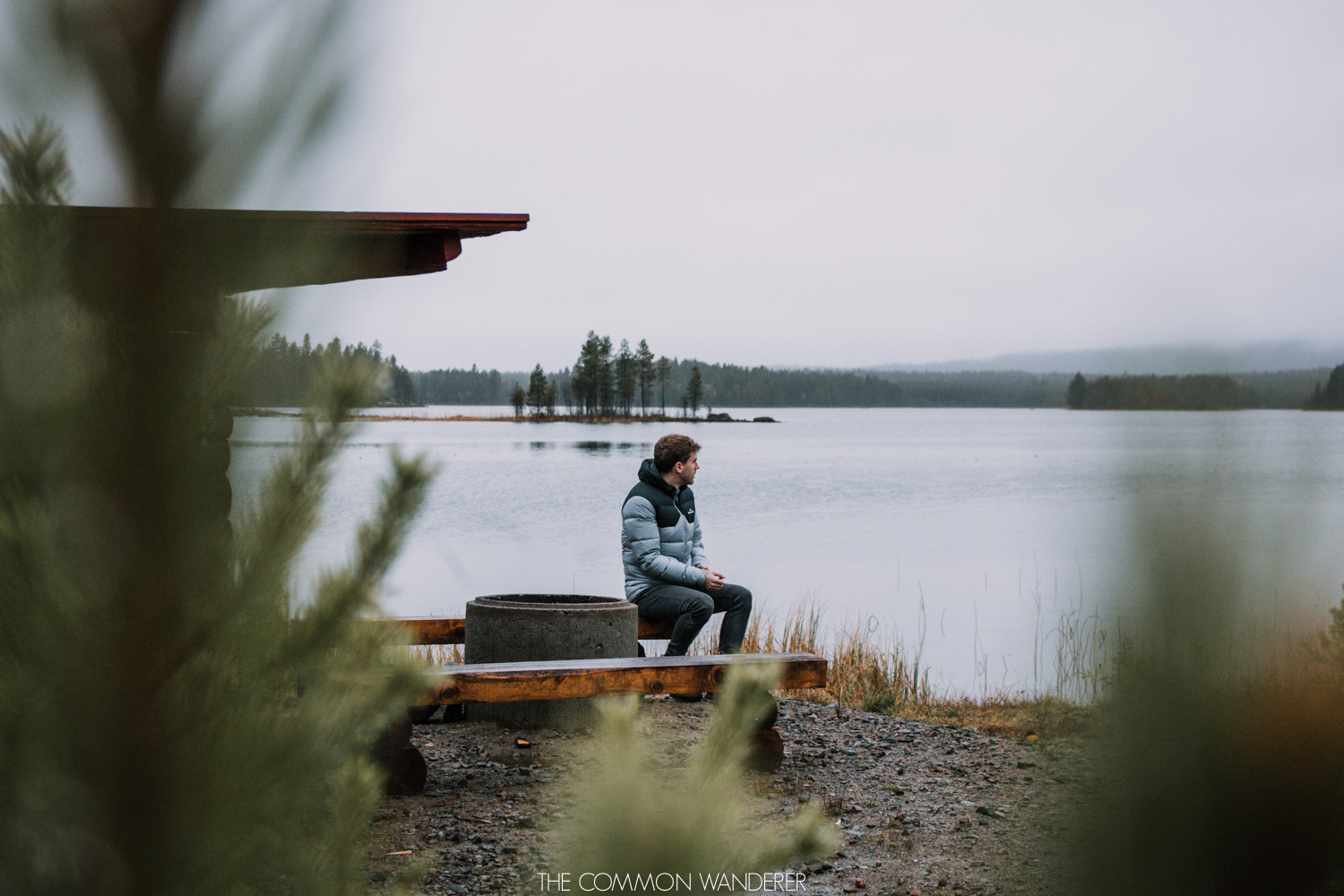 Lapland Pictures: Man sitting by lake in Swedish Lapland