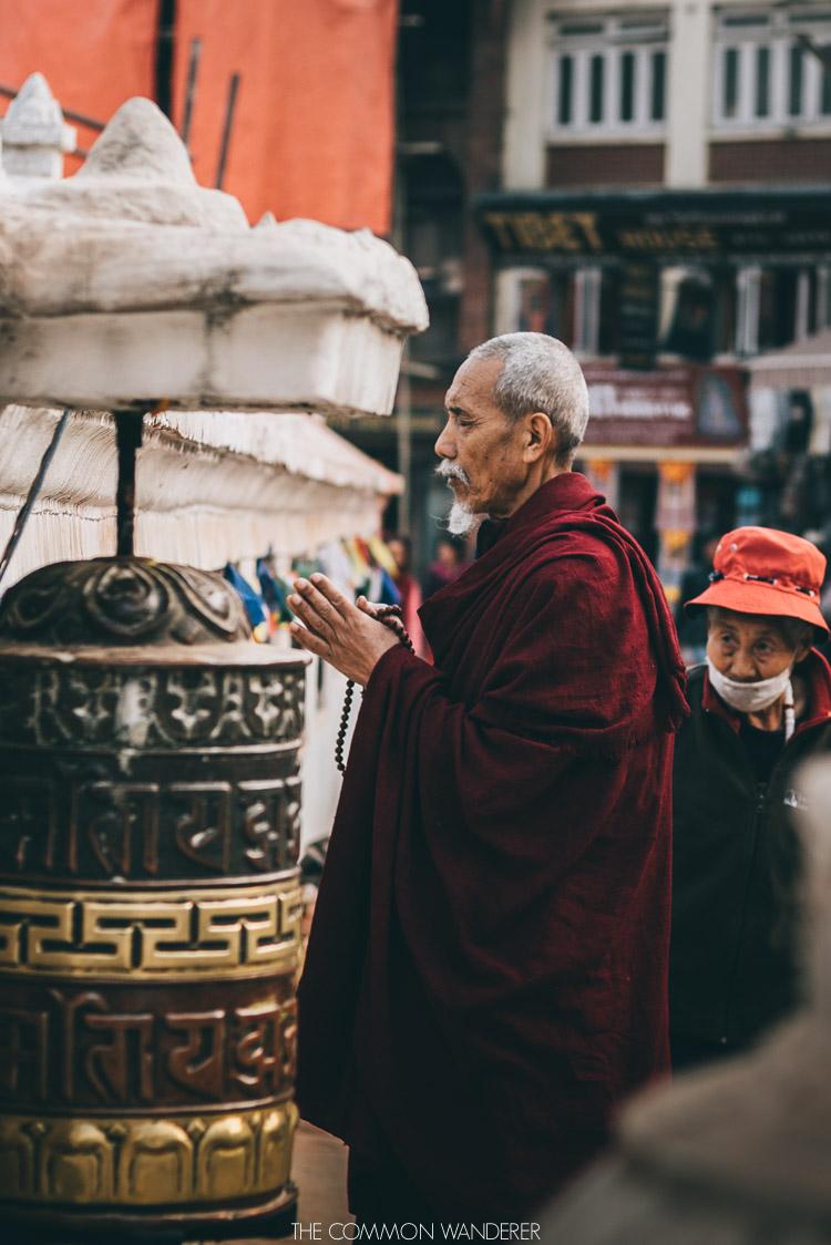 praying at Boudhanath Stupa - 30 photos that will make you want to visit Nepal
