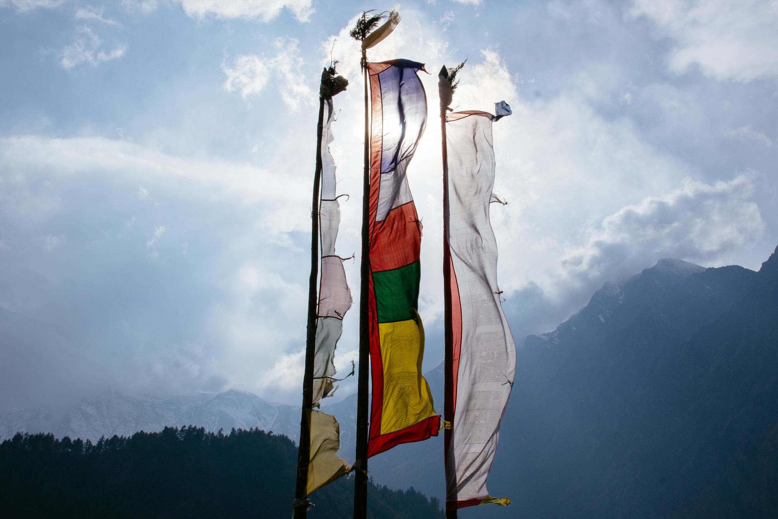 Prayer flags in the breeze in the Annapurna ranges - discovering the temples of Nepal with Urban Adventures.jpg