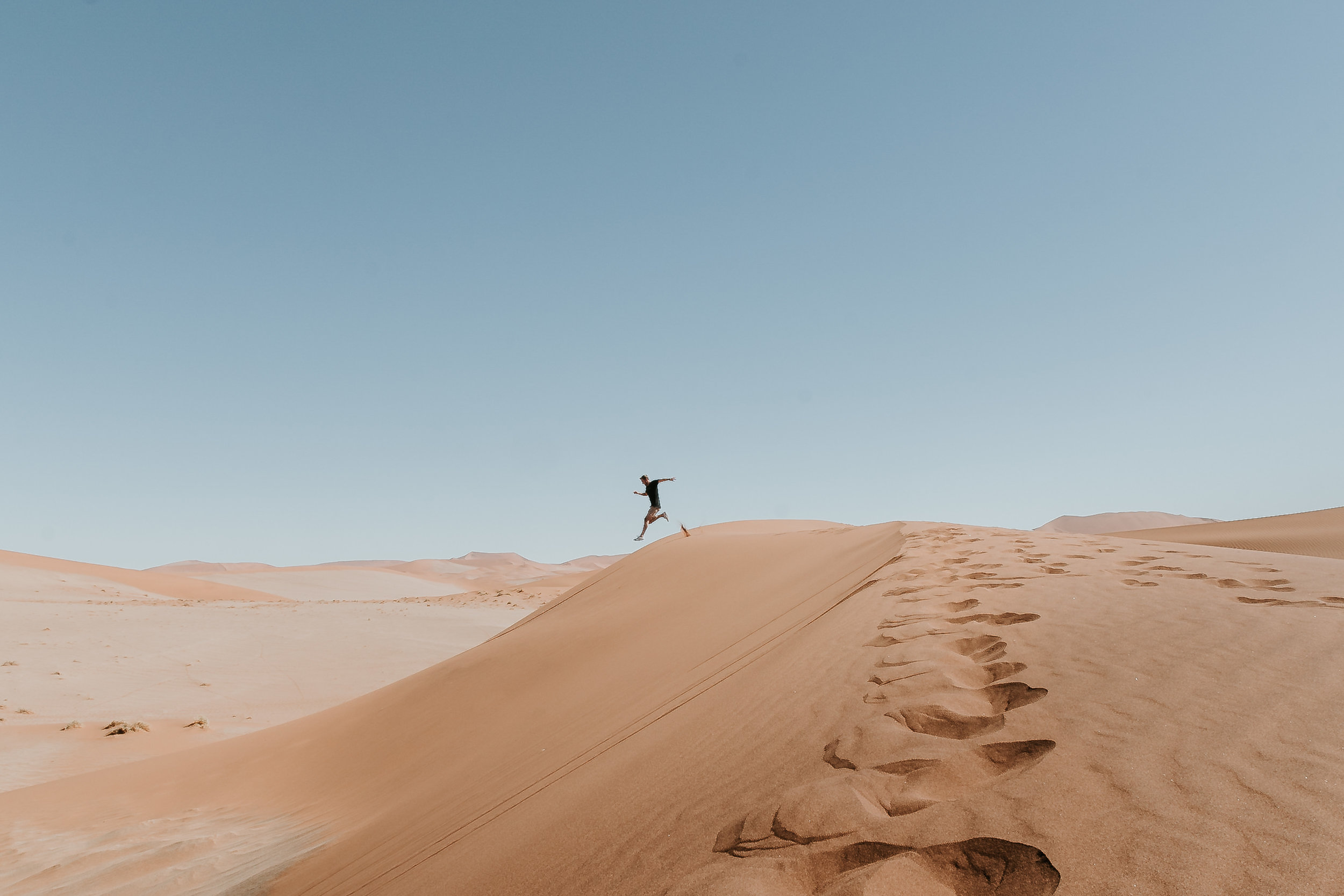 Jumping off a dune at Sossusvlei, Namibia - experiences to have in southern africa