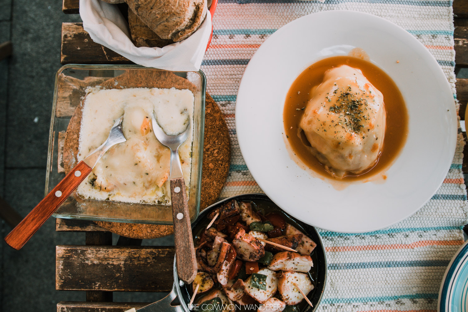 Local food in Porto - Francesinha, grilled octopus, and fresh bread