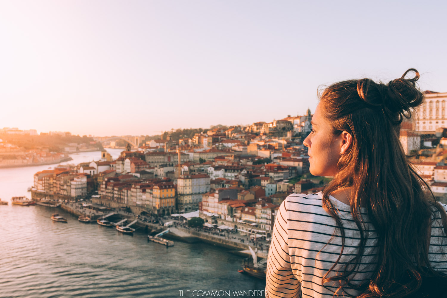 Looking out from Dom Luis I Bridge to the Ribeira district of Porto Portugal - Porto photo diary. The Common Wanderer | @thecommonwanderer