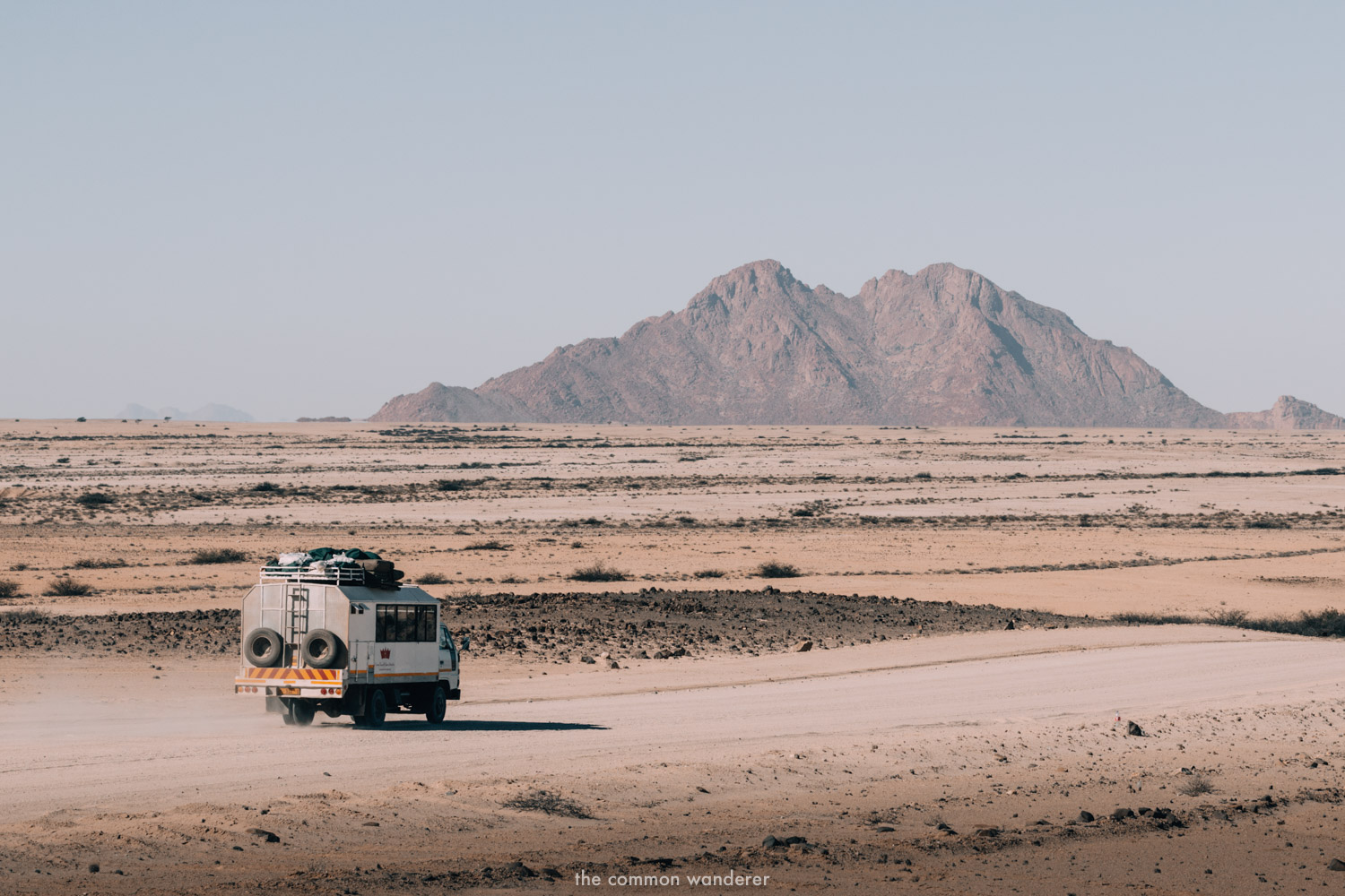 An overland bus travels through Namibia - overland can be a safe way to travel Africa