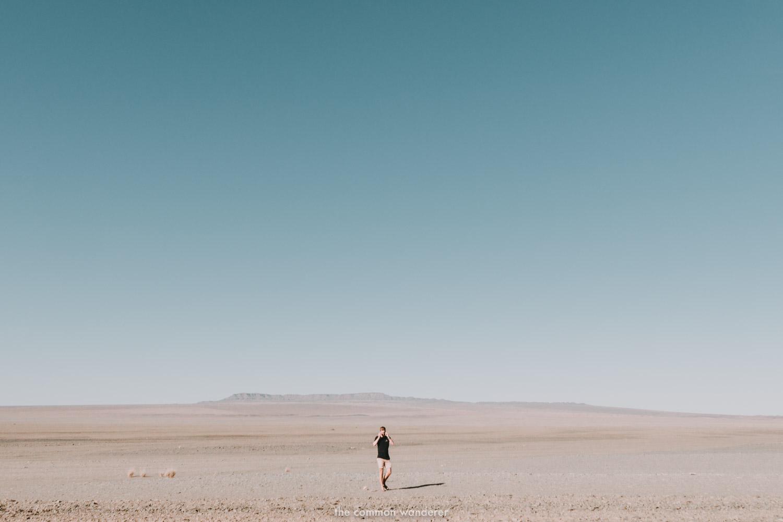 A man walks through the barren plains of Namibia - Namibia photos