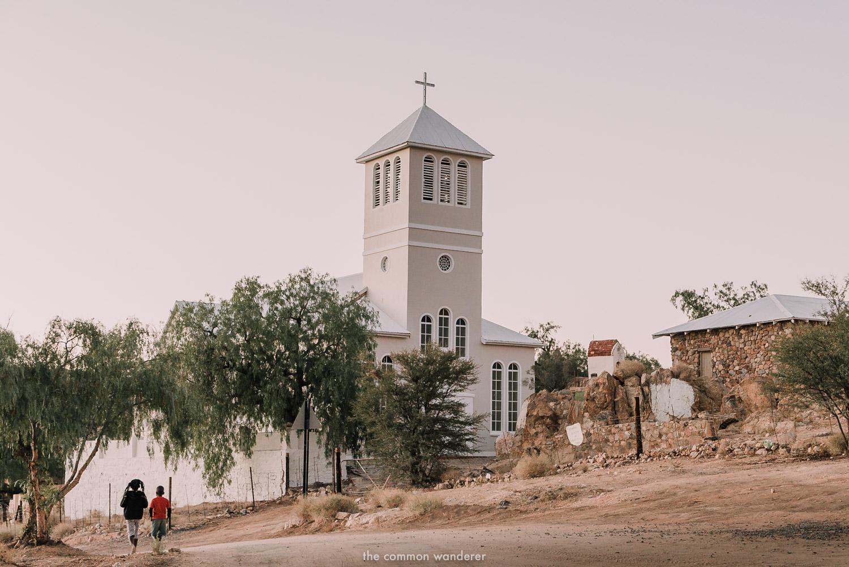 Children walk past Aus church, Aus, Namibia