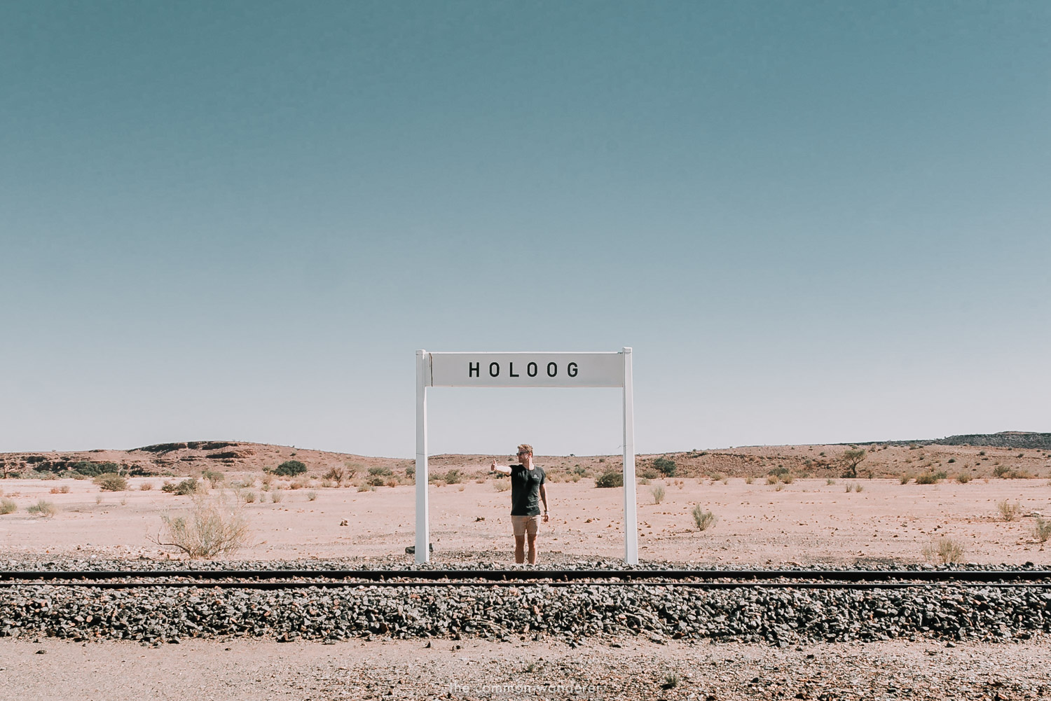 A man waits for a train that never arrives in Holoog, Namibia