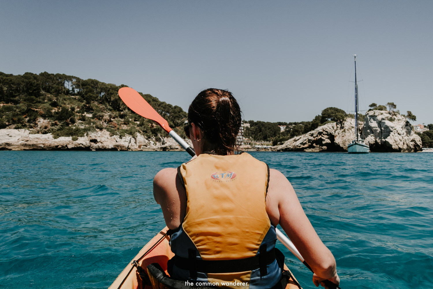 Kayaking through the turquoise waters of Menorca, Spain