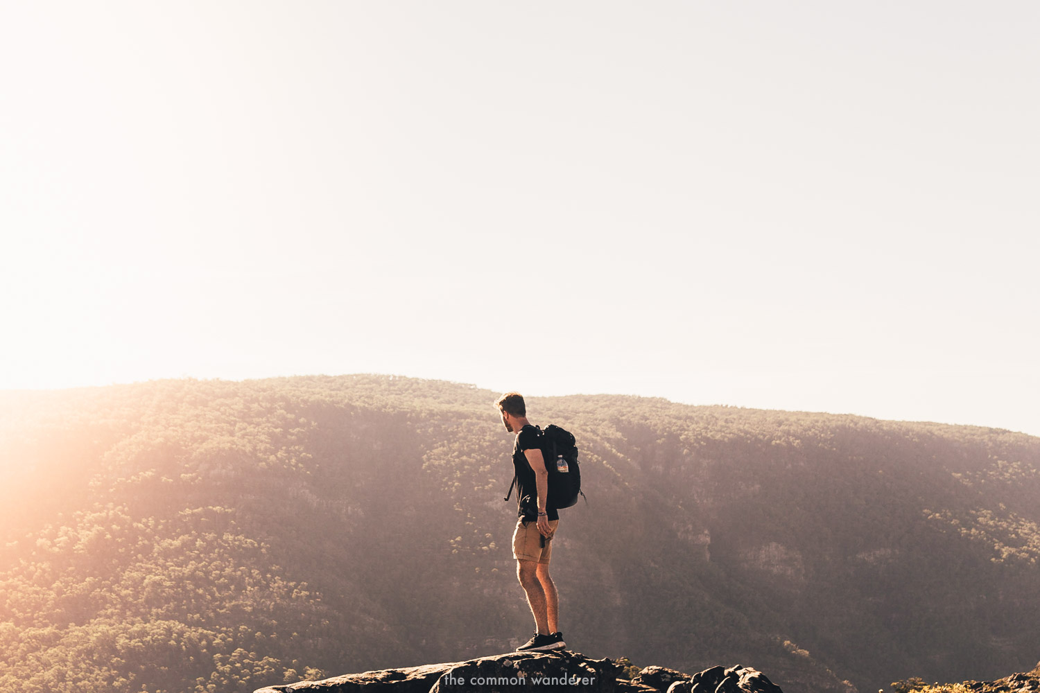 A man standing on rocks while hiking in the Grampians, Victoria