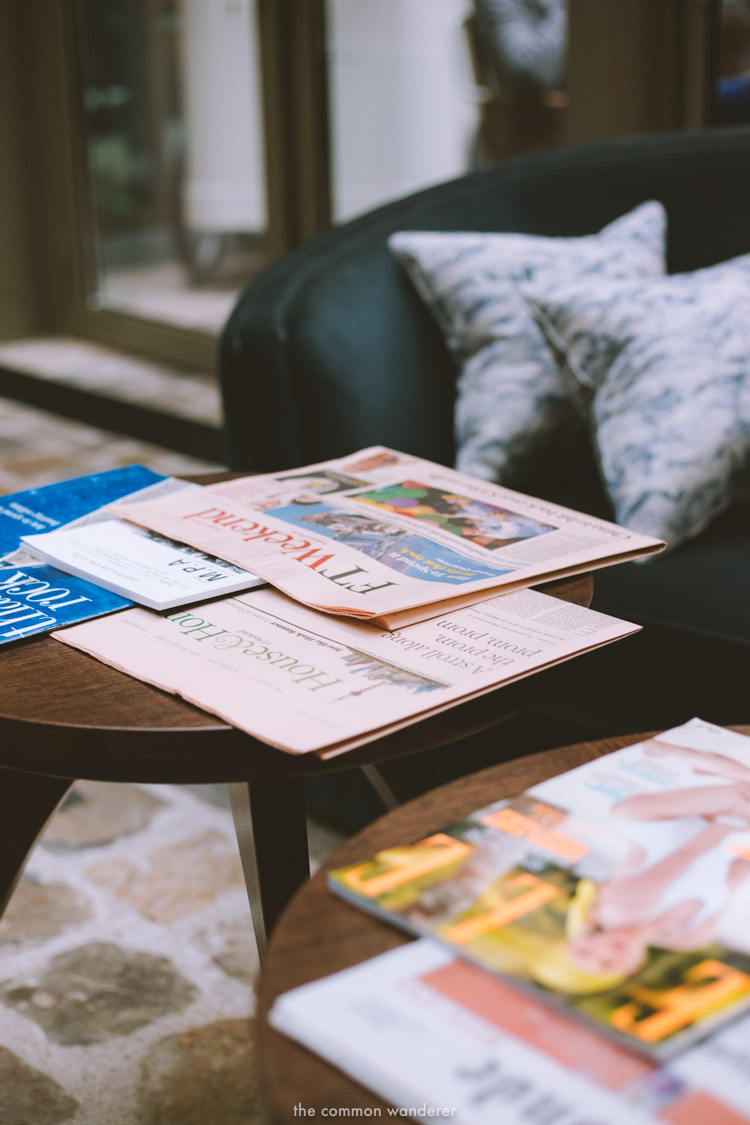 the day's papers rest on a coffee table in the main foyer of the hotel - THECOMMONWANDERER.COM