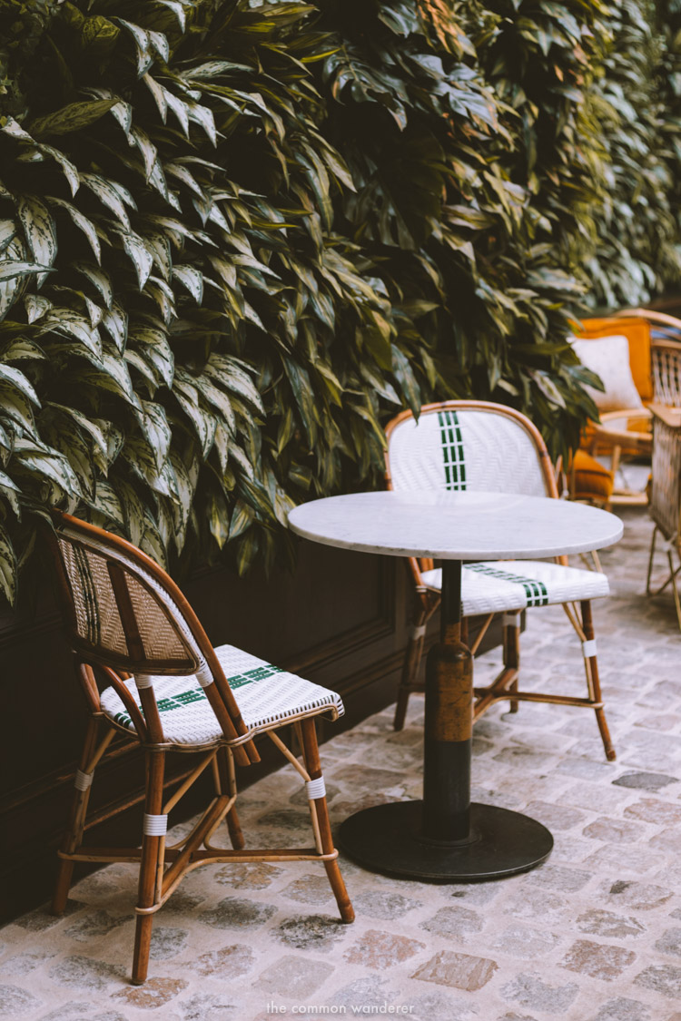 Two smoking chairs and a table sit by the living foliage wall at the hotel - THECOMMONWANDERER.COM