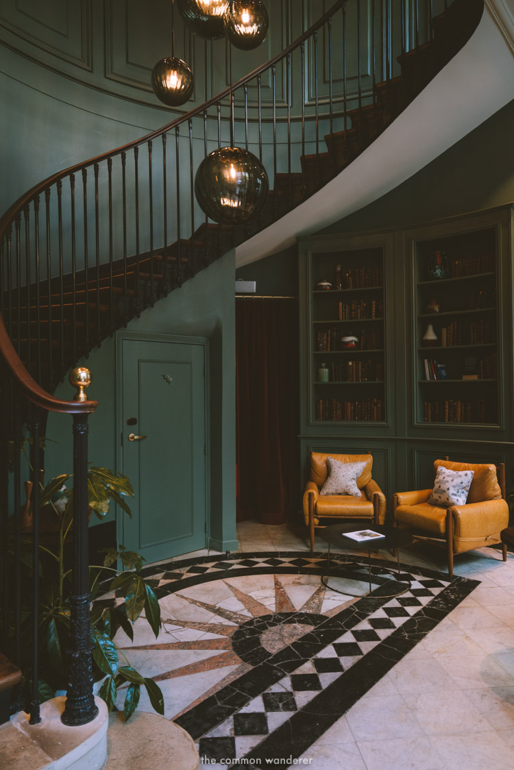 The instagram-famous old-Parisian style staircase leading from the main foyer - THECOMMONWANDERER.COM