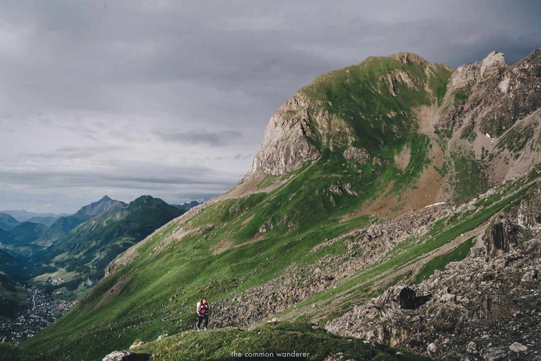 A woman hikes Der Grüne Ring, Lech Zürs am Arlberg, Austria