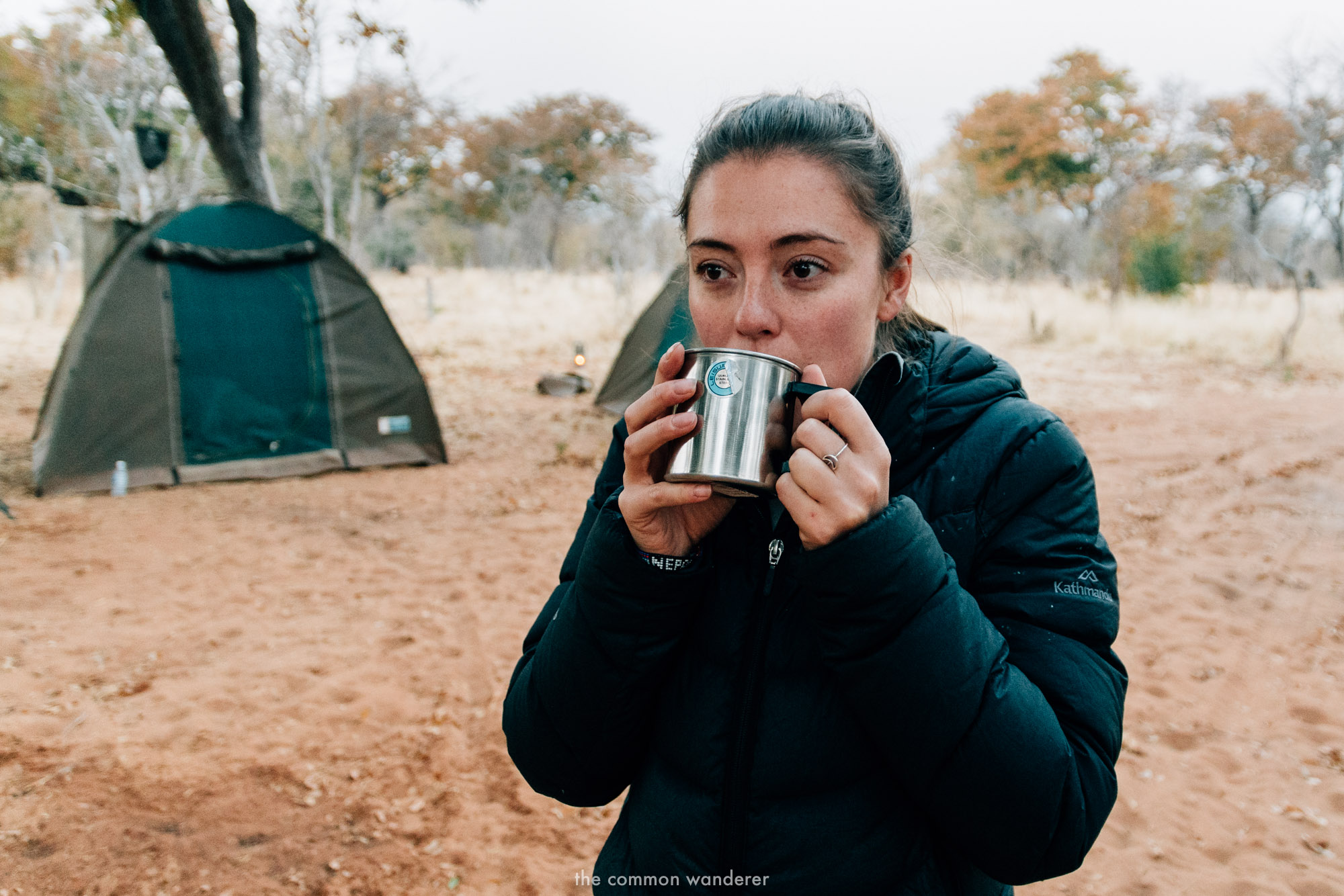 a woman drinking tea in Chobe National Park