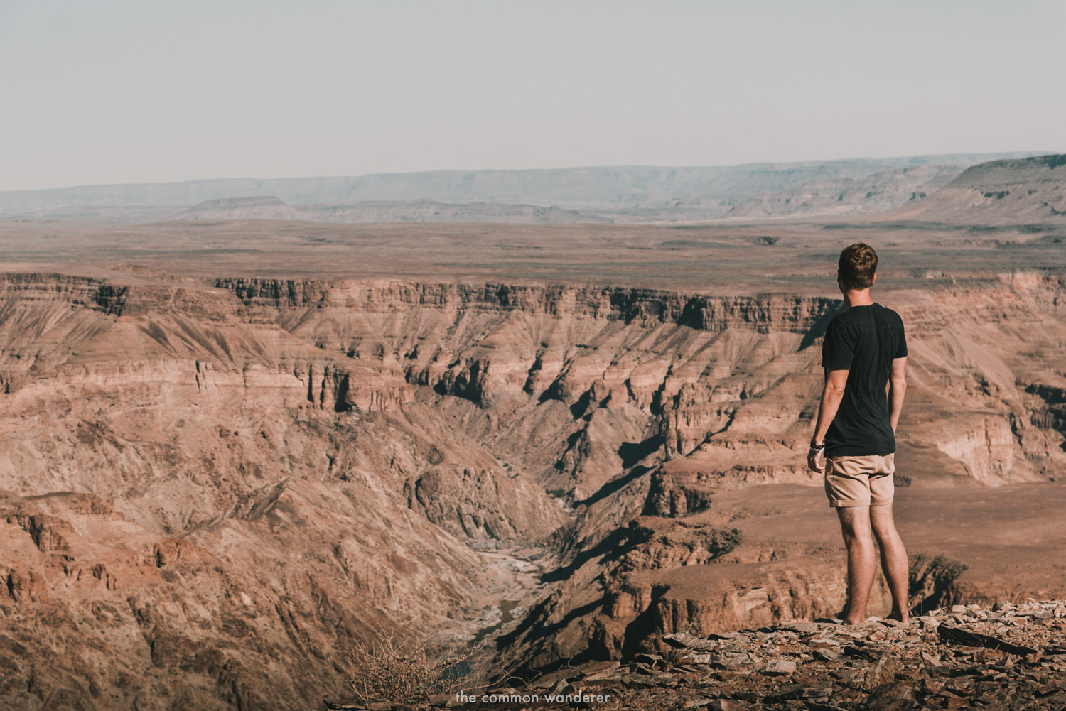 A man overlooks Fish River canyon in Namibia