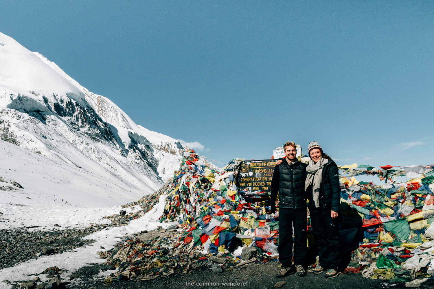 A couple on Thorong La pass after successfully completing the Annapurna Circuit trek, Nepal