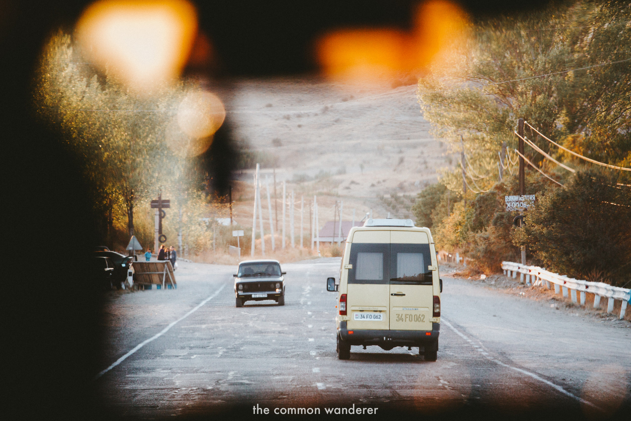 Cars driving along a road in Armenia