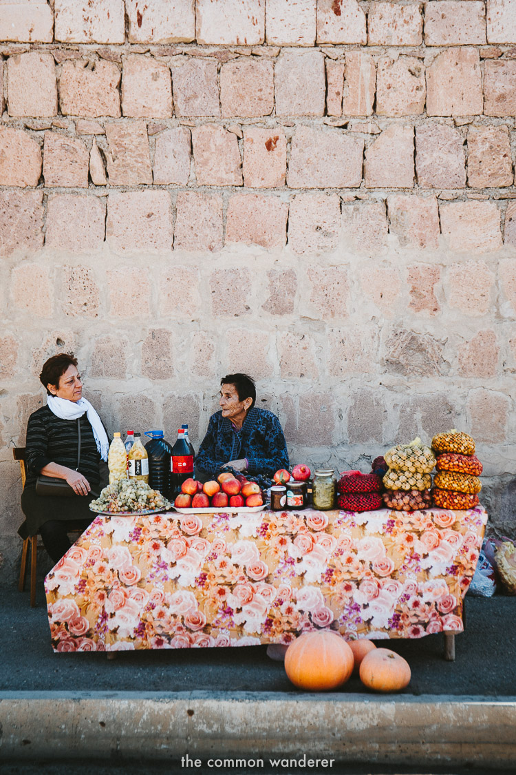 Women selling fruit in the town of Areni, Armenia