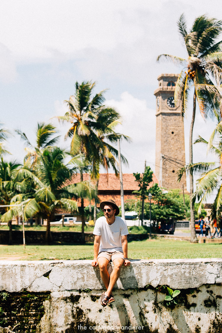 Sitting in front of the Galle Clock Tower, Galle Fort, Sri Lanka