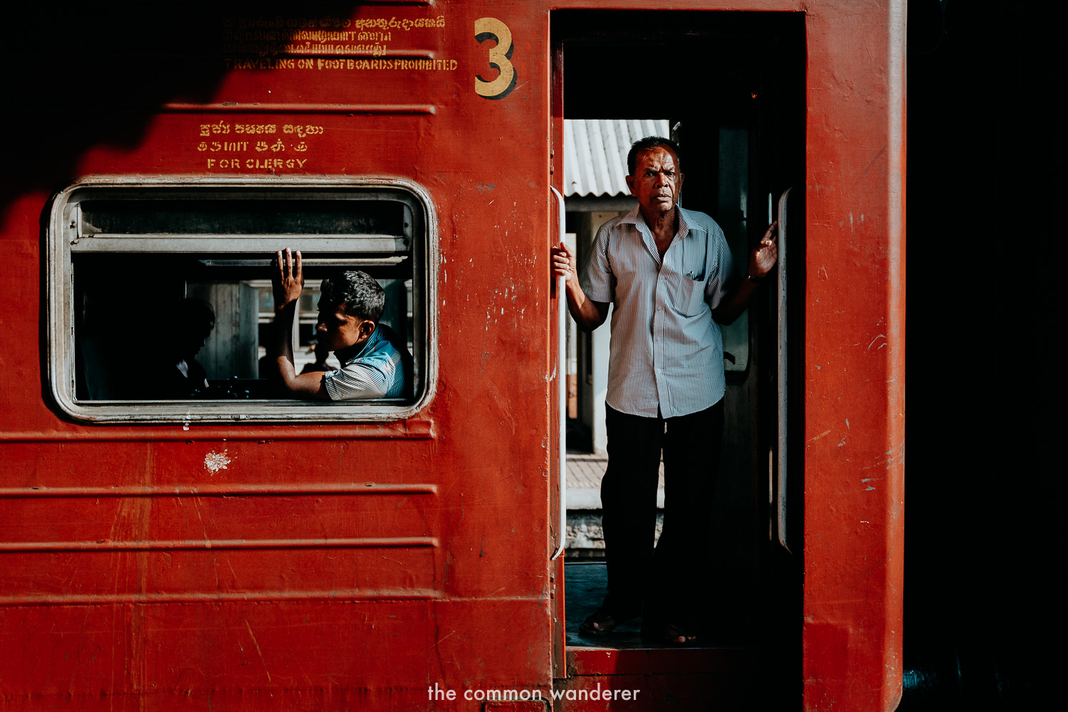 The best Sri Lanka photos | A man looks out of a train at Colombo Fort Station