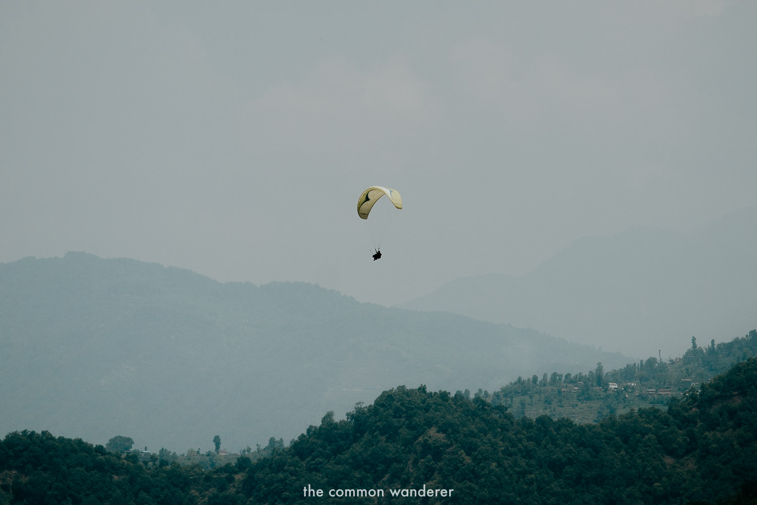 Floating above Pokhara while paragliding - one of the best things to do in Pokhara