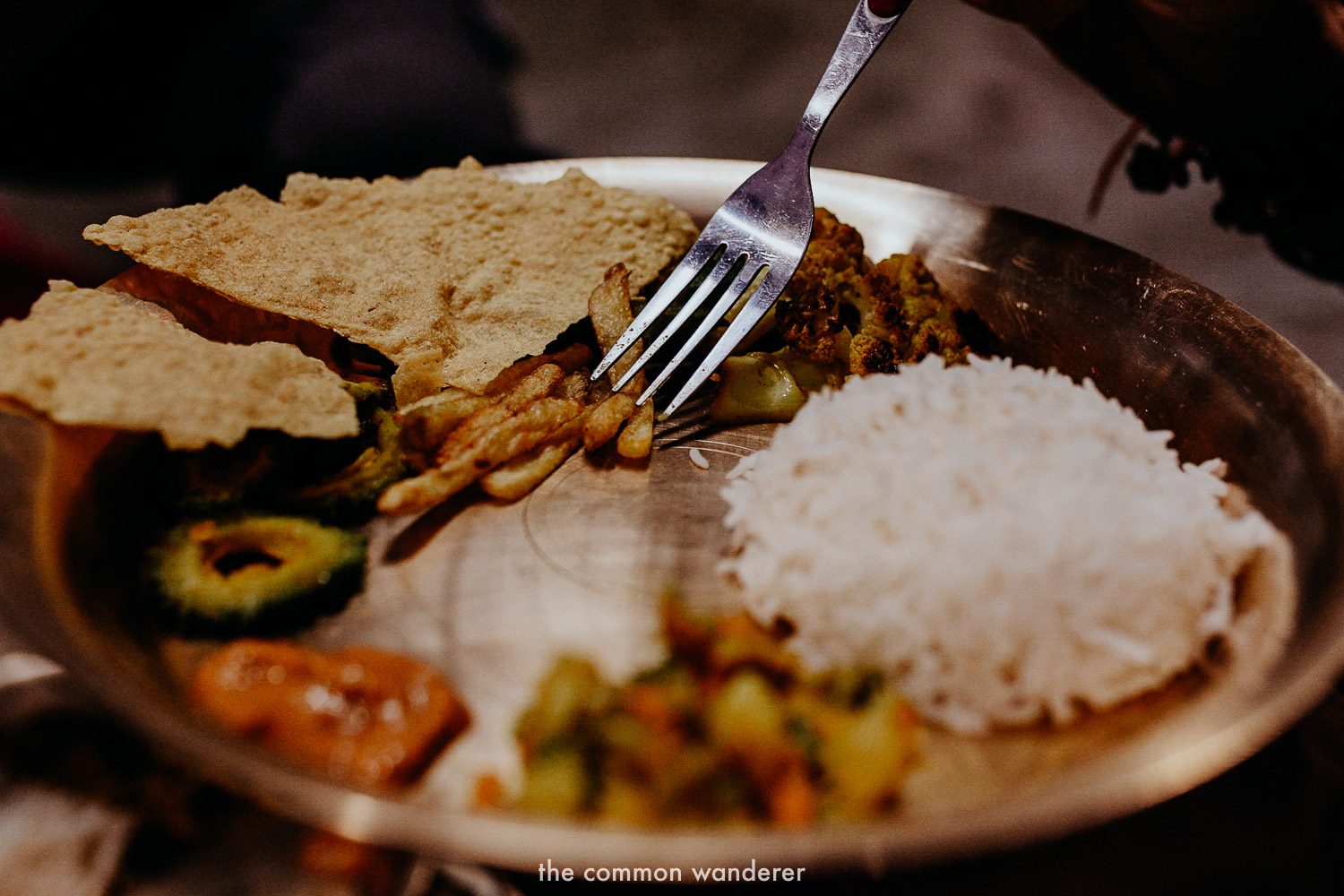 Eating dinner including dal bhat on our Panauti Community Homestay program in Nepal
