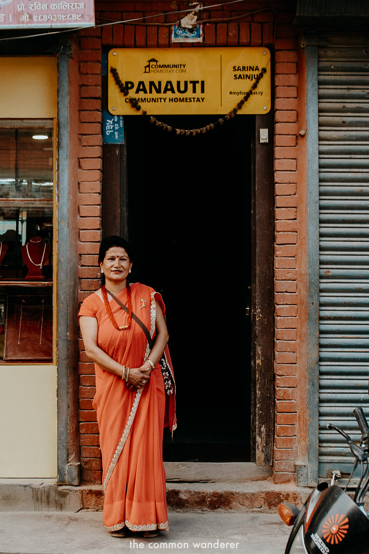 Sarina, our Panauti Homestay host stands in front of her front door