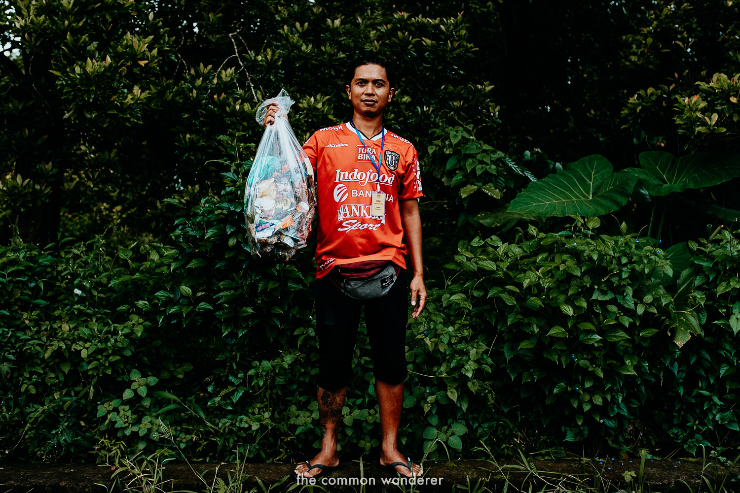 Our guide, Kadek, with a bag of rubbish we picked up in Sekumpul Waterfall, Bali