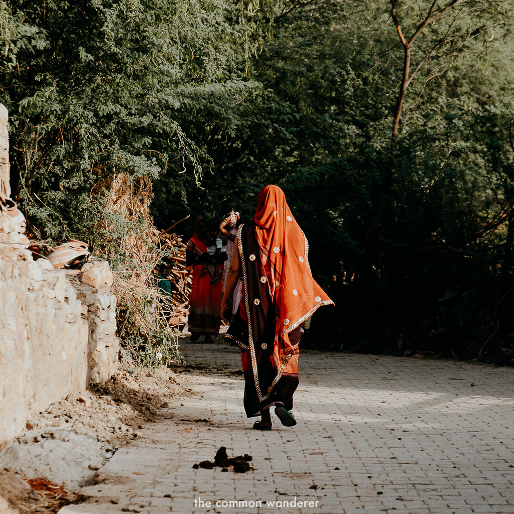 A woman walks through the village of Theekarda, Rajasthan