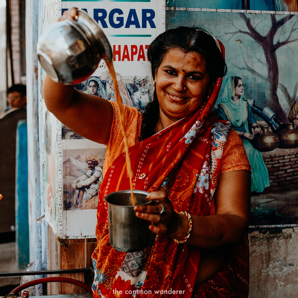 Sunita pours chai into a cup in Bundi
