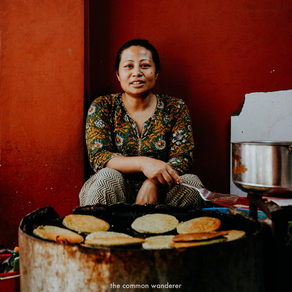 A lady make fresh lentil pancakes in Kathmandu, Nepal