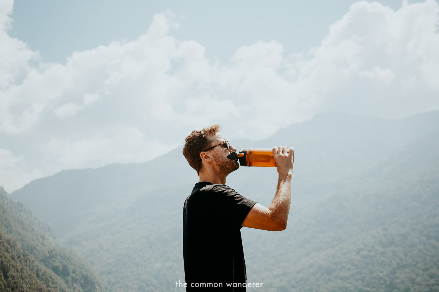 Drinking from the Grayl bottle while hiking in Nepal