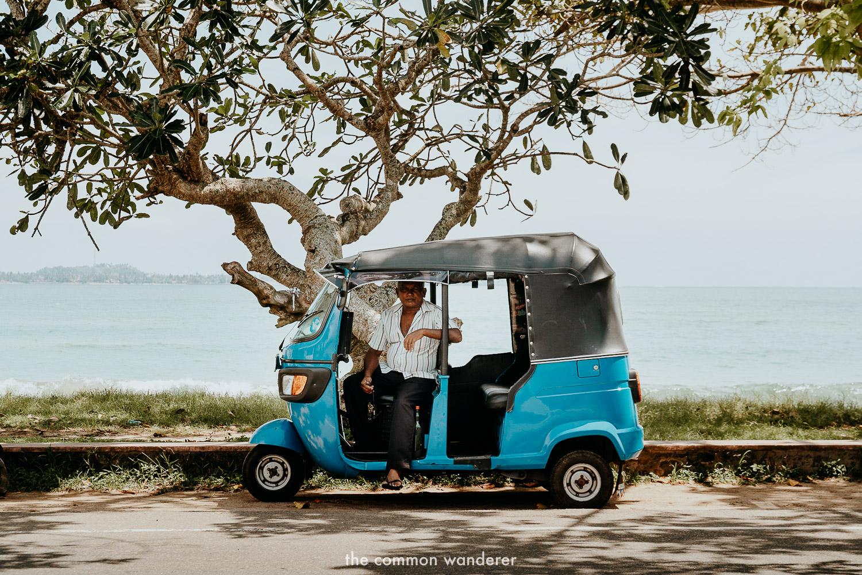 a tuk tuk driver waits for a fare in Weligama, Sri Lanka